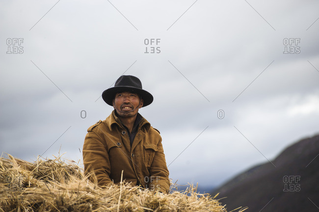 Portrait of a Tibetan man, Tibetan plateau, Kham and Amdo