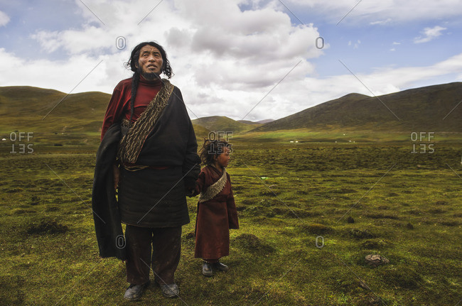 A Tibetan nomad father with his son on the meadows of the Tibetan plateau at 4200m