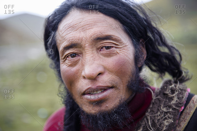 Portrait of a Tibetan man, Tibetan plateau, Kham and Amdo
