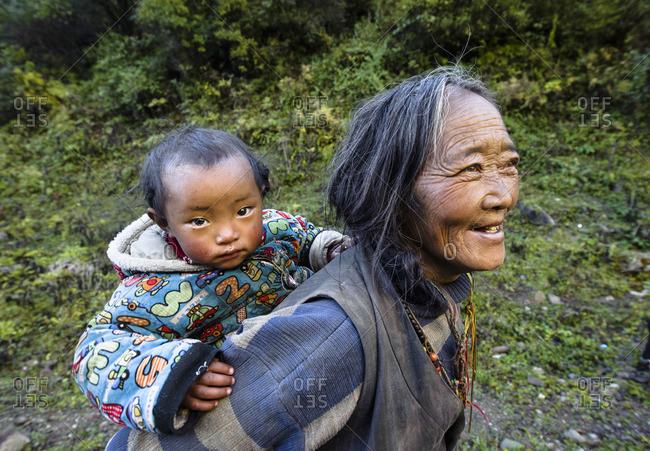 January 1, 1970: Tibetan grandmother and grandson, Tibetan plateau