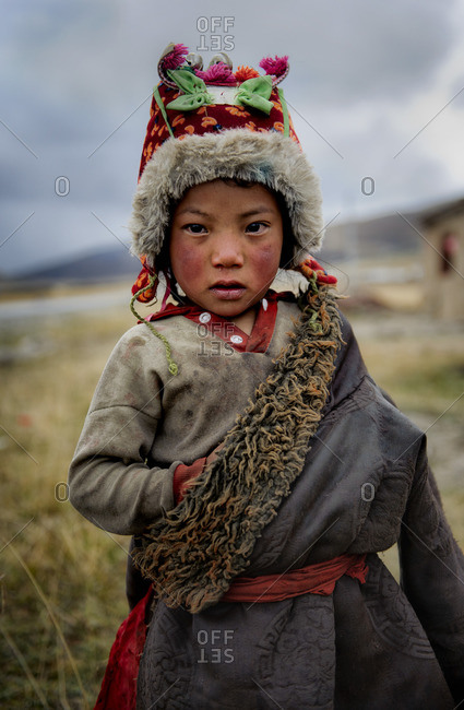 Tibetan child with traditional clothing, Tibetan plateau