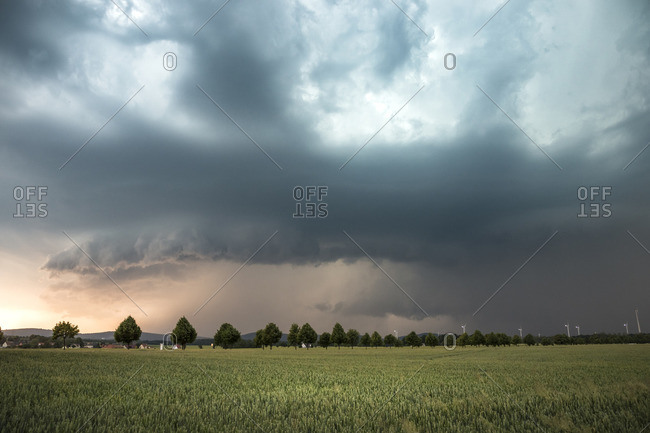 Downwind dominant HP supercell with gust front and wall cloud in the light of sunset near Kamenz, Saxony, Germany