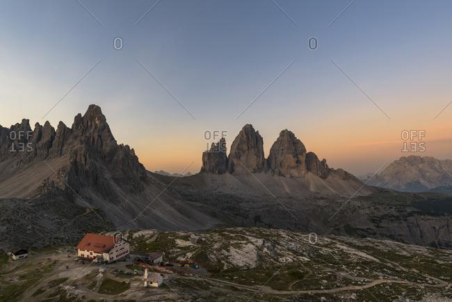 January 1, 1970: Three Peaks and Three Peaks hut at sunrise, Nature Park Three Peaks, Dolomites, South Tyrol, Italy