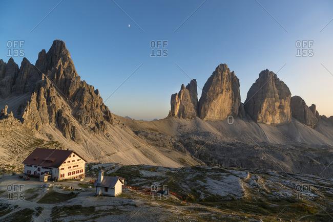 January 1, 1970: Three Peaks and Three Peaks hut at sunset, Nature Park Three Peaks, Dolomites, South Tyrol, Italy