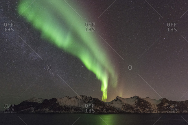 Northern lights over the Metfjord at night, Senja, Norway