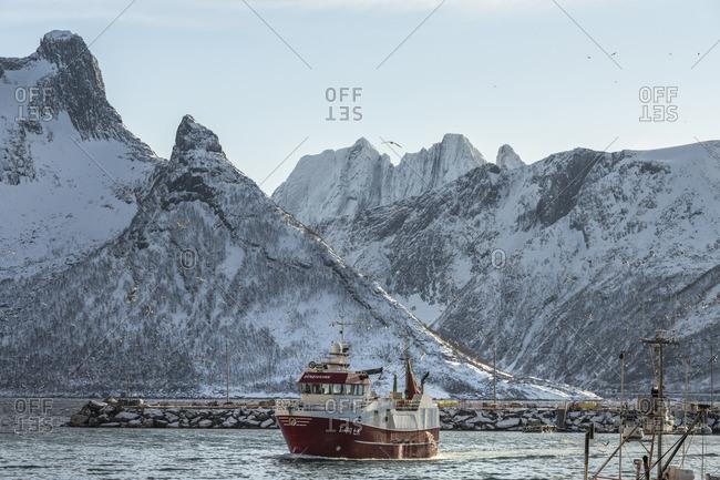 January 1, 1970: Oyfjord with fishing village Husoy, Senja, Norway