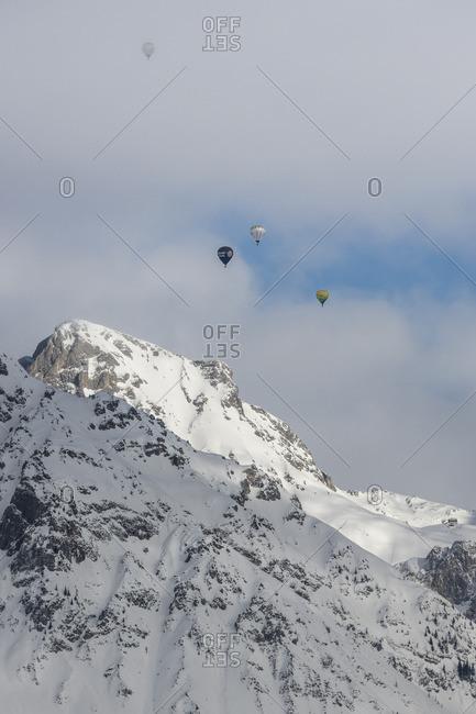 January 1, 1970: View from Rohrmoos, Dachstein massif, hot air balloons, Austria