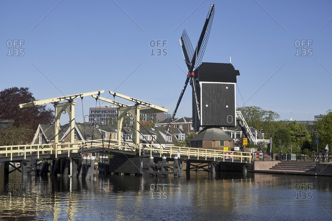 May 2, 2018: Rembrandt Bridge at Galgewater with Molen de Put in Leiden, South Holland, Netherlands