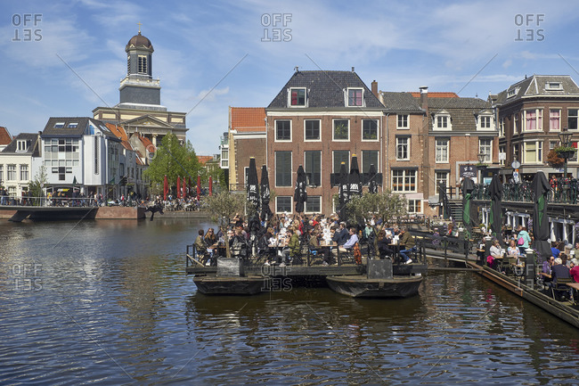 May 2, 2018: View from the Aalmarkt over the Rijn to the Hartebrugkerk in Leiden, South Holland, the Netherlands