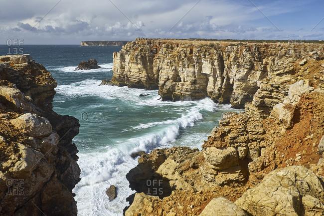 Rocky coast at Cabo de Sao Vicente with stormy sea near Sarges, Algarve, Faro, Portugal