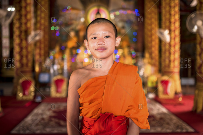 Young monk in a temple, Laos