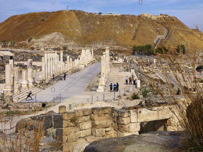 November 25, 2010: Palladius street of ancient city Bet She'an with Tell in the Jordan sink, Israel