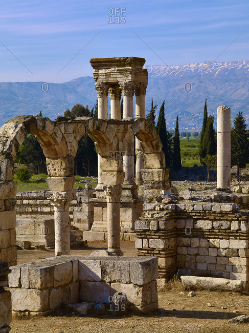 Lebanon Mountains and tetrapylon of the ancient city of Anjar, meaning Haoush Mousa, Lebanon, Middle East