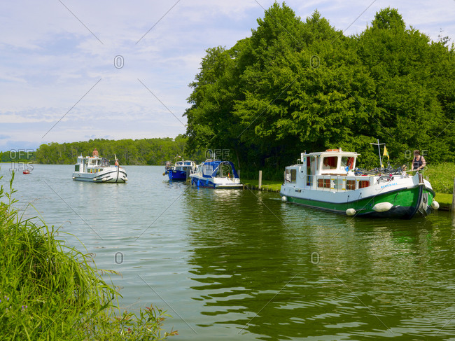 July 23, 2010: Ship traffic at the lock from Lake Haussee to Lake Stolpsee, Himmelpfort near Fuerstenberg, Brandenburg, Germany