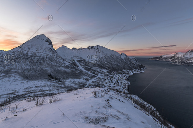 View from Mount Barden to Mount Segla at the Oyfjord at sunset, Senja, Norway