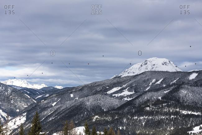 January 24, 2018: View from Rohrmoos, Dachstein massif, hot air balloons, Austria