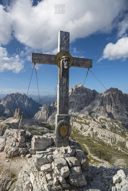 August 30, 2017: Summit cross on the summit of the Paternkofel, Tre Cime di Lavaredo, Tre Cime Natural Park, Dolomites, South Tyrol, Italy