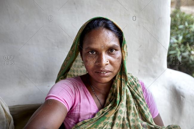 Manipuri Village, Sreemangal, Bangladesh - May 01, 2013: Portrait of a Manipuri woman sitting outdoors