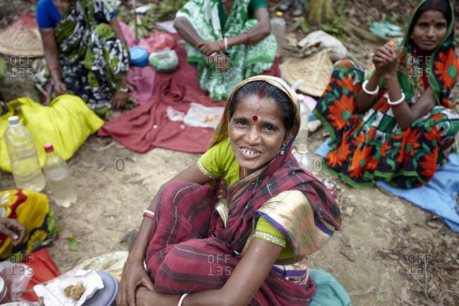 Sreemangal, Bangladesh - May 2, 2013: Group of tea workers women having rest during lunch time at a tea plantation near Sreemangal, Sylhet, Bangladesh