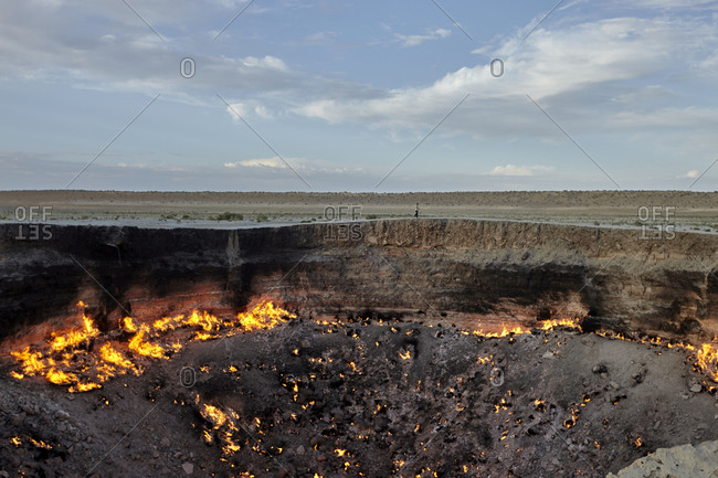 The Darvaza gas crater, a natural gas field collapsed into a cavern located in the middle of the Karakum Desert in Turkmenistan