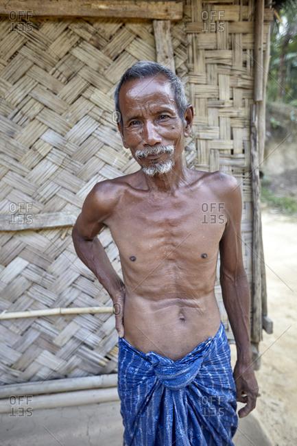 Garo Line Para Village, Sreemangal, Bangladesh - May 2, 2013: Portrait of a senior Garo tribal man