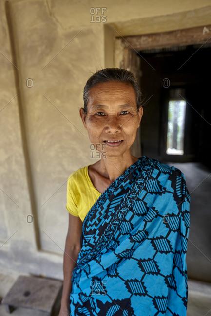 Garo Line Para Village, Sreemangal, Bangladesh - May 2, 2013: Portrait of a Garo tribal woman in front of a house