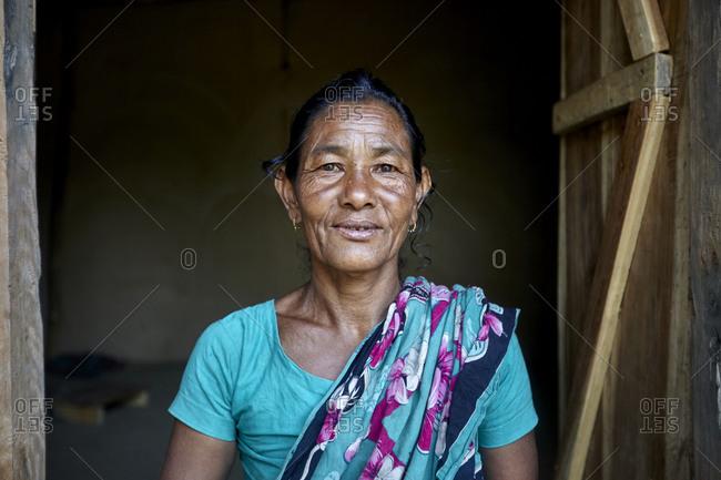 Garo Line Para Village, Sreemangal, Bangladesh - May 2, 2013: Portrait of a Garo tribal woman standing in her doorway