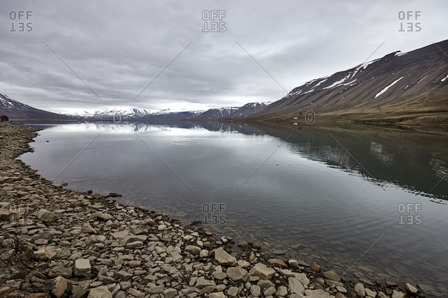 Panoramic view of mountains on a cloudy day nearby Arctic Bay, Longyearbyen, Svalbard archipelago, Spitsbergen, Svalbard, Norway