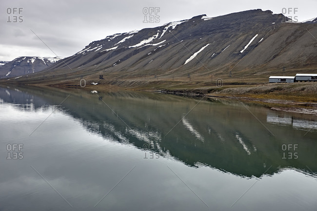 Panoramic view of mountains covered by snow on a cloudy day nearby Arctic Bay, Longyearbyen, Svalbard archipelago. Spitsbergen, Svalbard, Norway