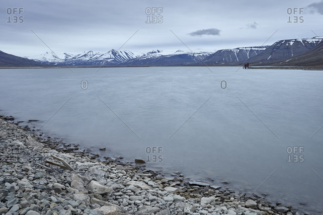 Magnificent arctic landscape with a lake and a cabin on Spitsbergen island, Svalbard archipelago, Spitsbergen, Svalbard, Norway