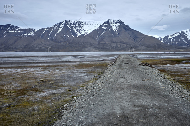 Magnificent arctic landscape with a lake and an empty road on Spitsbergen island, Svalbard archipelago, Spitsbergen, Svalbard, Norway