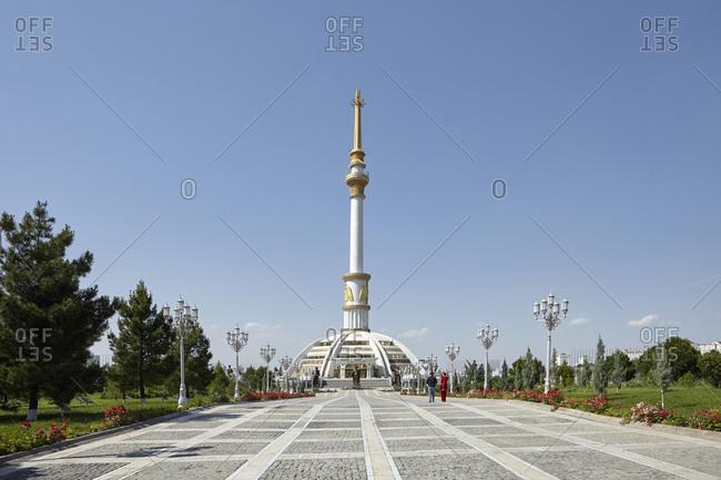 Ashgabat, Turkmenistan - May 14, 2016: Tourists visiting the Independence Monument in Ashgabat