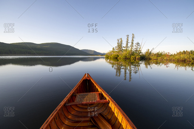 Wood and canvas canoe on a summer morning on Bristol Pond, Bristol, Vermont