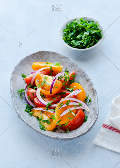 Heirloom tomato salad with olive oil on plate from above