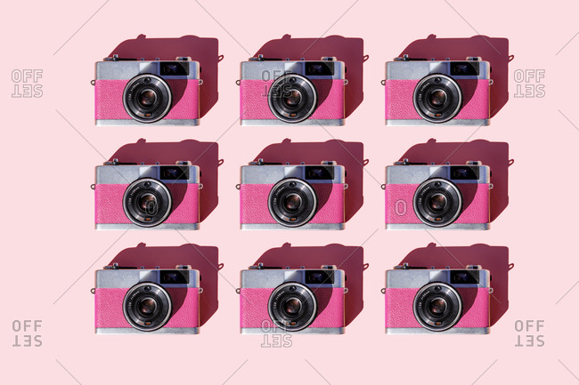 Pattern of rows of vintage analog cameras