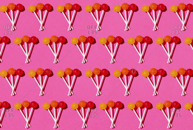 Pattern of lollipops against pink background