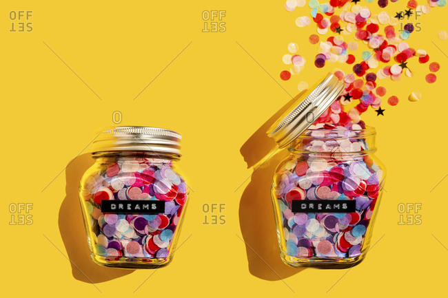 Closed and open jar of colorful confetti