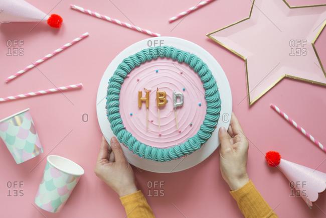 Hands of woman preparing birthday cake