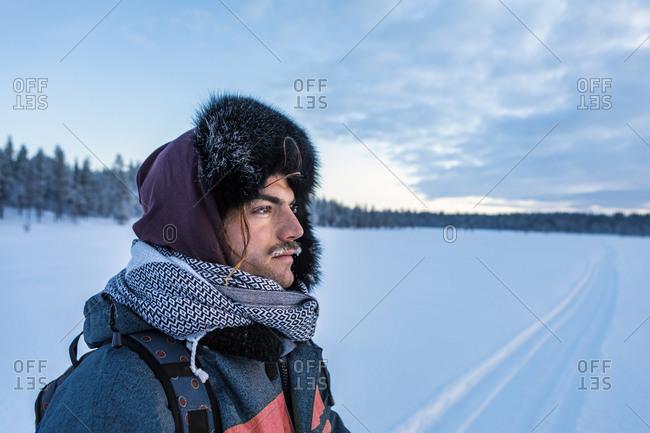 Portrait of man in winter landscape with frozen moustache- Ounasjaervi- Enontekioe- Finland
