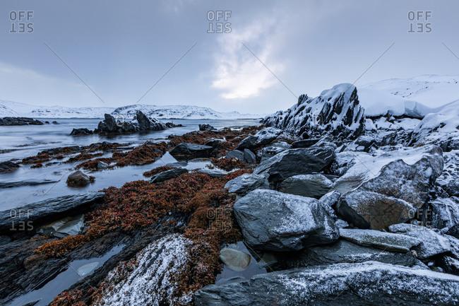 Coastal landscape with rocks in winter- Berlevag- Norway