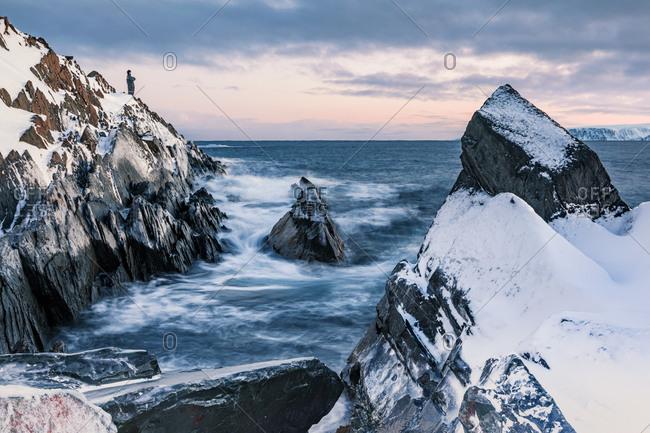 Man in coastal landscape in winter- Berlevag- Norway
