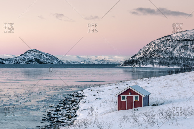 Coastal landscape with red hut in winter- Lebesby- Lakse Fjord- Norway