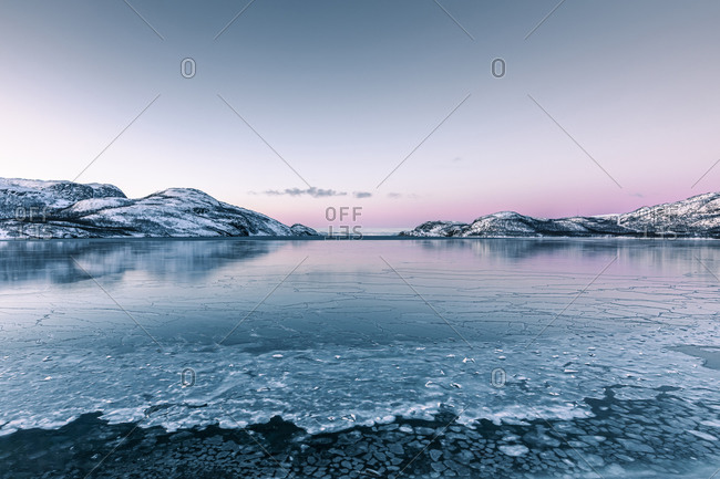 Coastal landscape in winter with frozen Lakse Fjord- Lebesby- Norway