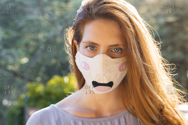 Portrait of redheaded woman with mask