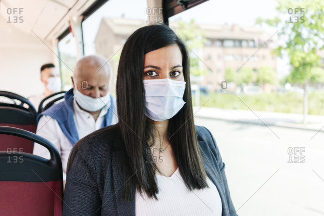 Portrait of woman wearing protective mask in public bus- Spain