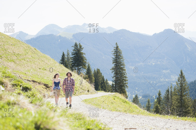 Hiking couple on hiking trail in summer- Wallberg- Bavaria- Germany