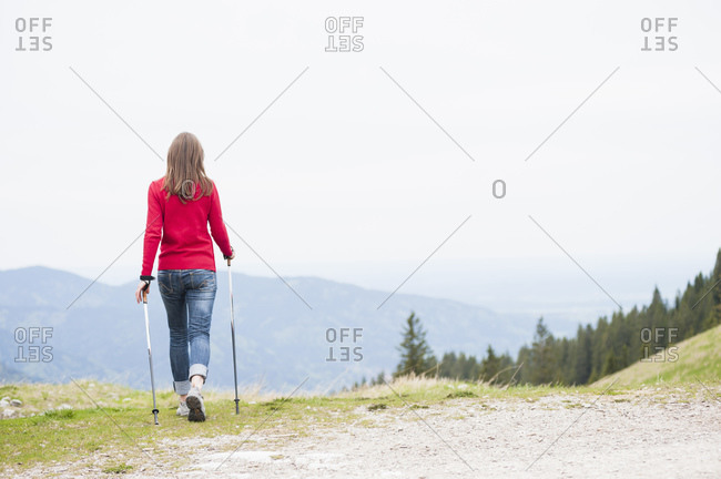Rear view of woman with hiking poles