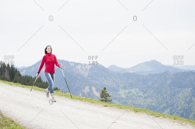 Smiling woman with hiking poles- Wallberg- Bavaria- Germany