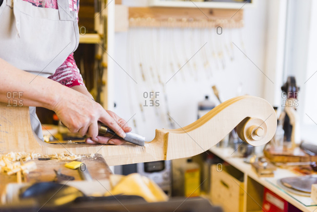 Female violin maker at work