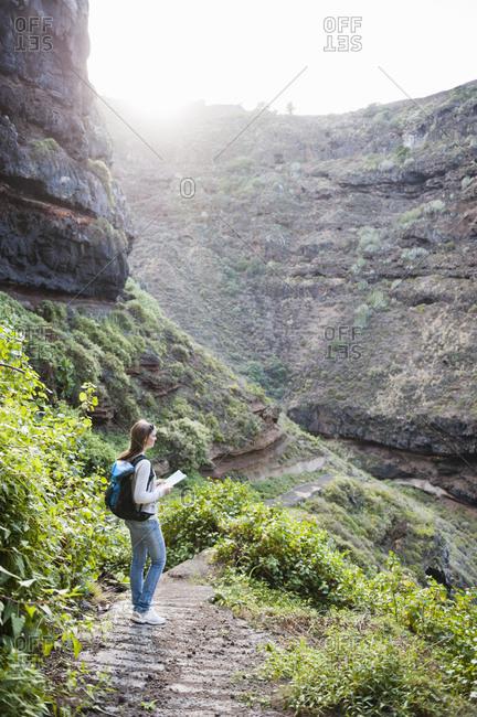 Female hiker with map- Tenerife- Balearic Islands- Spain